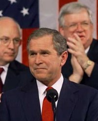 George W. Bush. (The fat ugly guy behind him is Speaker Hastert)