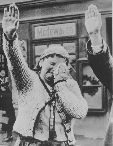 A Czech woman weeps while saluting Nazi occupiers